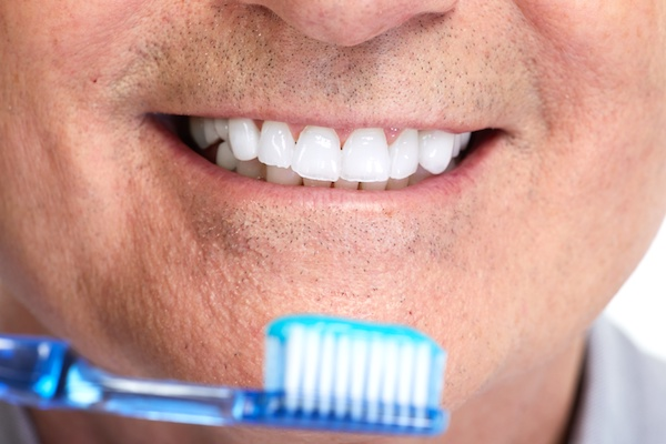 Handsome smiling mature man teeth with toothbrush